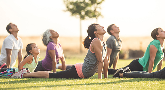 Group of people doing yoga in park