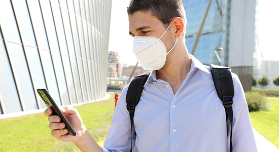 Man wearing mask on smartphone