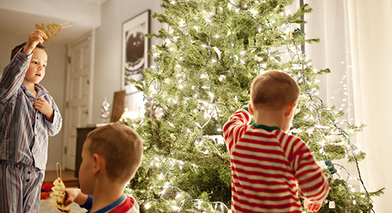 Children decorating with holiday lights