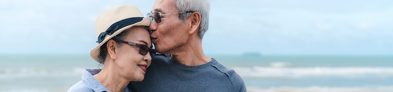 Couple in their 60s on beach together