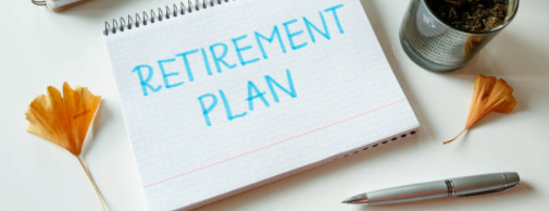 retirement-plan-written-in-notebook-on-table-s-962311818